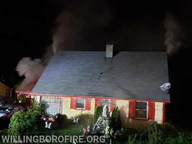 Heavy smoke from the roof upon arrival